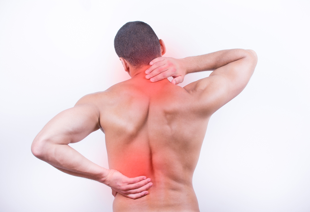 A man's back displaying areas of pain