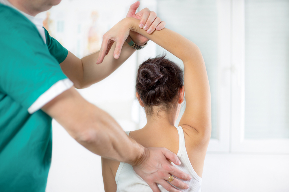 Woman getting chiropractic care in Rye, NY.